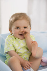 Baby girl  (6-11 months) finger in mouth, portrait - SMOF00426