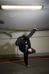 Man performing break dancing, portrait. - PKF00369