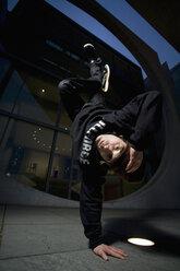 Man performing break dancing, portrait. - PKF00354