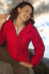 Italy, Alto Adige, Woman in trekking outfit, smiling, close-up - KEF00013