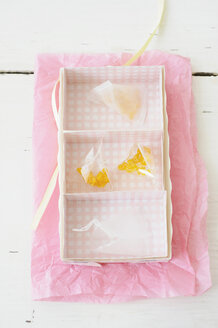 Candied lemon twist in rack on wax paper - COF00136