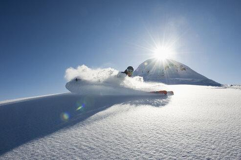 Austria, Man skiing on arlberg mountain - MIRF00061
