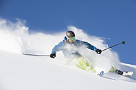 Austria, Man skiing on arlberg mountain - MIRF00058