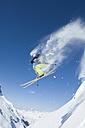 Austria, Man jumping on arlberg mountain - MIRF00055