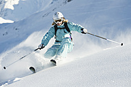 Austria, Woman skiing on arlberg mountain, smiling - MIRF00046