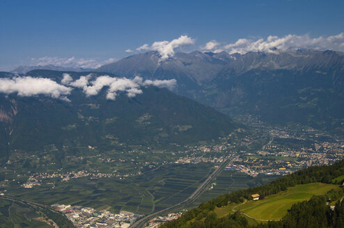 Italy, South Tyrol, Meran, Elevated view of city with mountains in background - SMF00617
