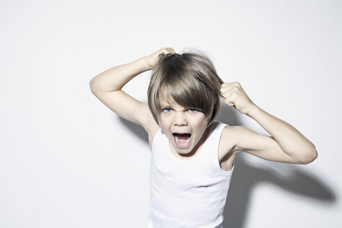 Boy (8-9) pulling hair and shouting, portrait - PDF00012