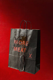 Brown paper bag on red background - HOEF00265