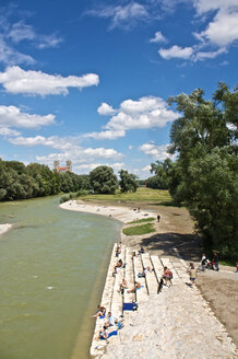 Germany, Bavaria, Munich, People at river isar with st. maximilian church in background - LFF00158