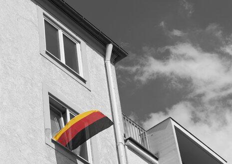 Germany, Bavaria, Munich, German flag on window - LFF00155