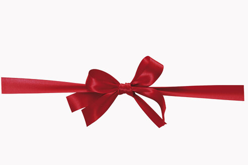 Red bow against white background, close-up - 13074CS-U
