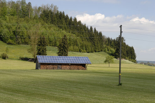 Germany, Bavaria, Wood shack with solar cell roof - CRF01904