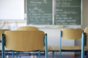 Germany, Bavaria, Chairs and blackboard in classroom - TCF01306