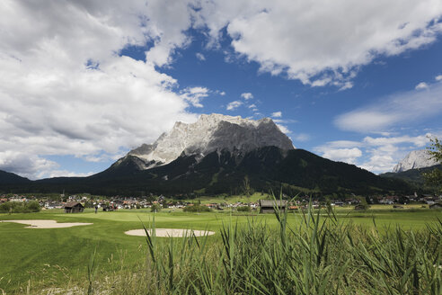 Austria, Tyrol, Ehrwald, Zugspitz, View of golf course with mountains in background - CSF013571
