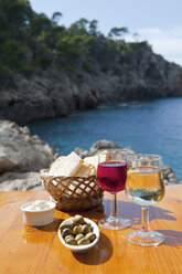 Spain, Mallorca, Food on table with mountain in background - NHF001250