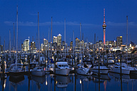 New Zealand, Auckland, North Island, View of boats with city skyline in background - GWF001199