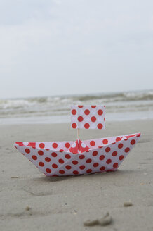 Germany, Northsea, Amrum, View of paper boat on the beach - AWDF000585
