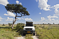 Africa, Botswana, Land vehicle passing through central kalahari game reserve - FOF002221