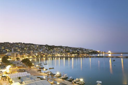 Greece, Crete, Sitia, View of city with harbor at dusk - MSF002395