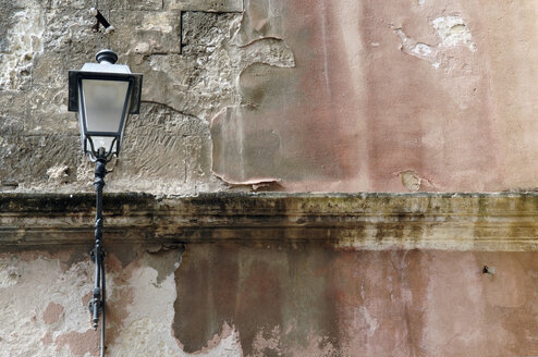 Italy, Sardinia, Cagliari, Street light on wall - LRF000519