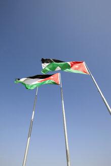 Jordan, View of Jordan national flags against sky - JMF000080