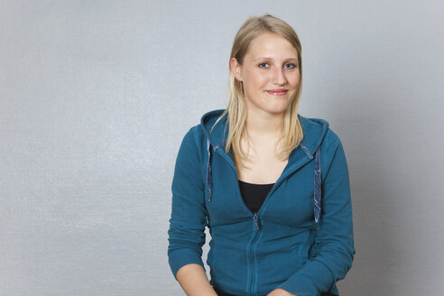 Germany, Berlin, Young woman smiling, close up, portrait - BAEF000118