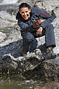 Italy, Trentino, Young woman playing with river water - KEF000052