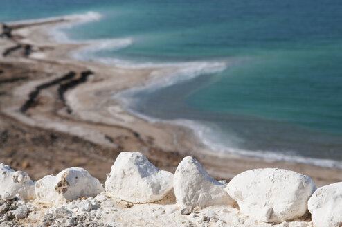 Jordan, Close up of rock with dead sea in background - NHF001235