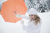 Austria, Altenmarkt, Young woman holing umbrella, portrait - HHF003415