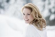 Austria, Altenmarkt, Young woman smiling, portrait - HHF003421