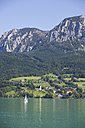 Austria, Salzkammergut, View of steinbach am attersee and attersee lake with hoellen mountains in background - WWF001580
