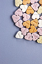 Heart shaped sweets with text on gray background - TLF000515