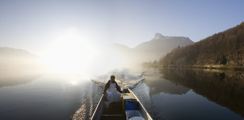 Austria, Mondsee, View of fisherman in boat near lake - WWF001679