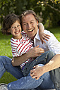 Germany, Bavaria, Father and daughter (8-9 Years) having fun at picnic, smiling, portrait - MAEF002579