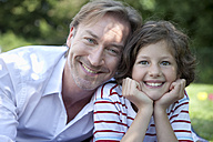 Germany, Bavaria, Father and daughter (8-9 Years) having fun at picnic, smiling, portrait - MAEF002596