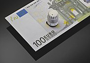 Thermostatic valve on 100 euro note, close up - WBF000214