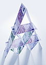 House of cards made up of euro notes on white background - WBF000229