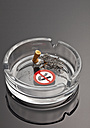 Cigarette in ashtray with no smoking sign - WBF000249