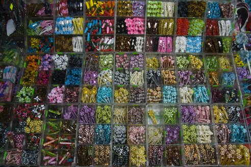Thailand, Bangkok, Variety of plastic jewellery at market - HKF000328