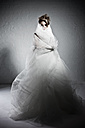 Young bride covering herself in modern dress, portrait - MF000428