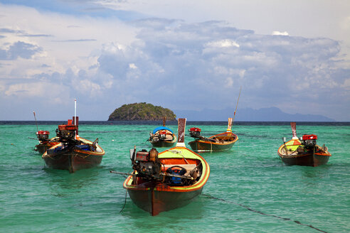 Thailand, Longtail Boat floating on water - NDF000166
