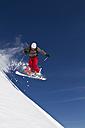 Austria, Kaprun, Kitzsteinhorn, Man skiing in mid air - FFF001123