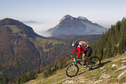 Austria, Tirol, Female mountain biker biking on spitzstein mountain - FFF001132