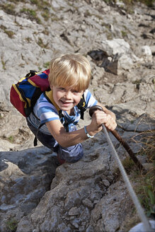 Germany, Bavaria, Boy (4-5 Years) climbing mountain, smiling, portrait - HSIF000007