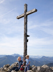 Germany, Bavaria, Father and son (4-5 Years) sitting on mountain summit - HSIF000023