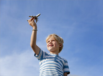 Germany, Bavaria, Boy (4-5 Years) playing with toy airplane - HSIF000011