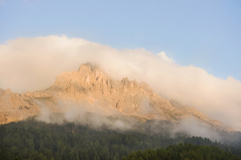 Italy, Dolomites, View of latemar mountains at sunset - RNF000552