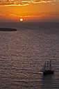 Europe, Greece, Thira, Cyclades, Santorini, View of sailing ships in aegean sea at sunset - FOF002776
