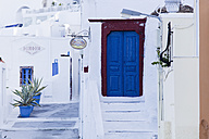 Greece, Cyclades, Thira, Santorini, Closed blue wooden door with stairs - FOF002835