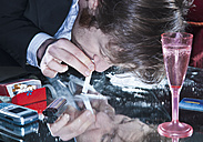 Young man sniffing cocaine - WBF000820